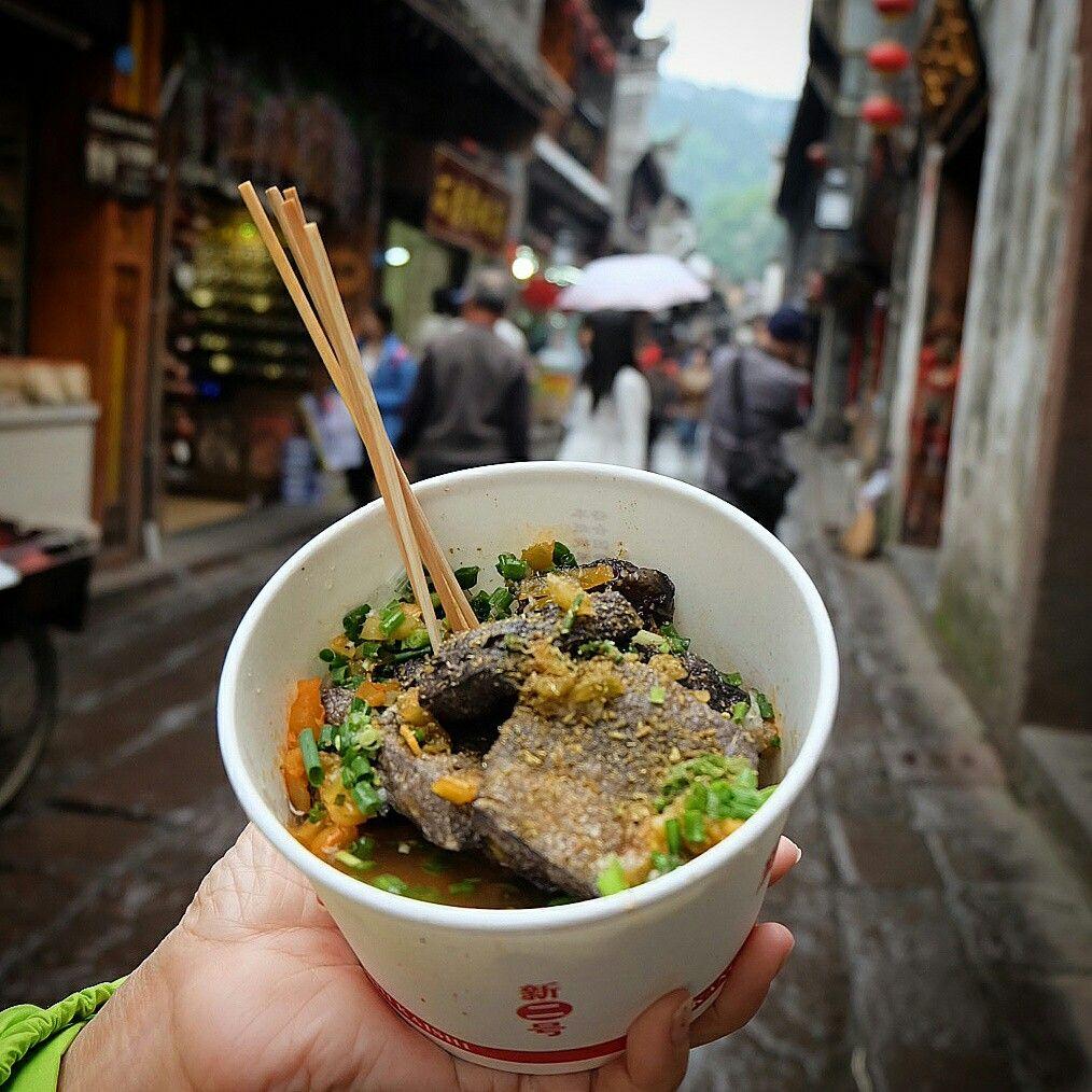 Stinky Black Tofu. Popular street food in Zhangjiajie