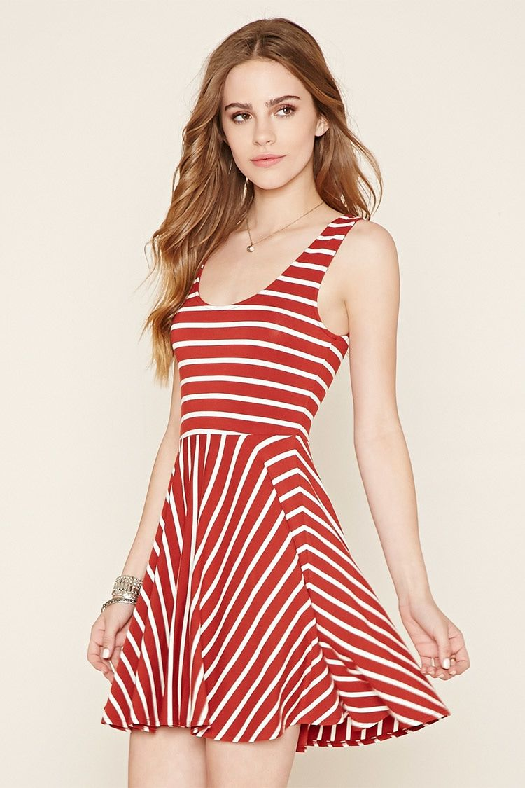 8ca1d1b78547 A sleeveless knit dress featuring allover stripes and a round neckline.