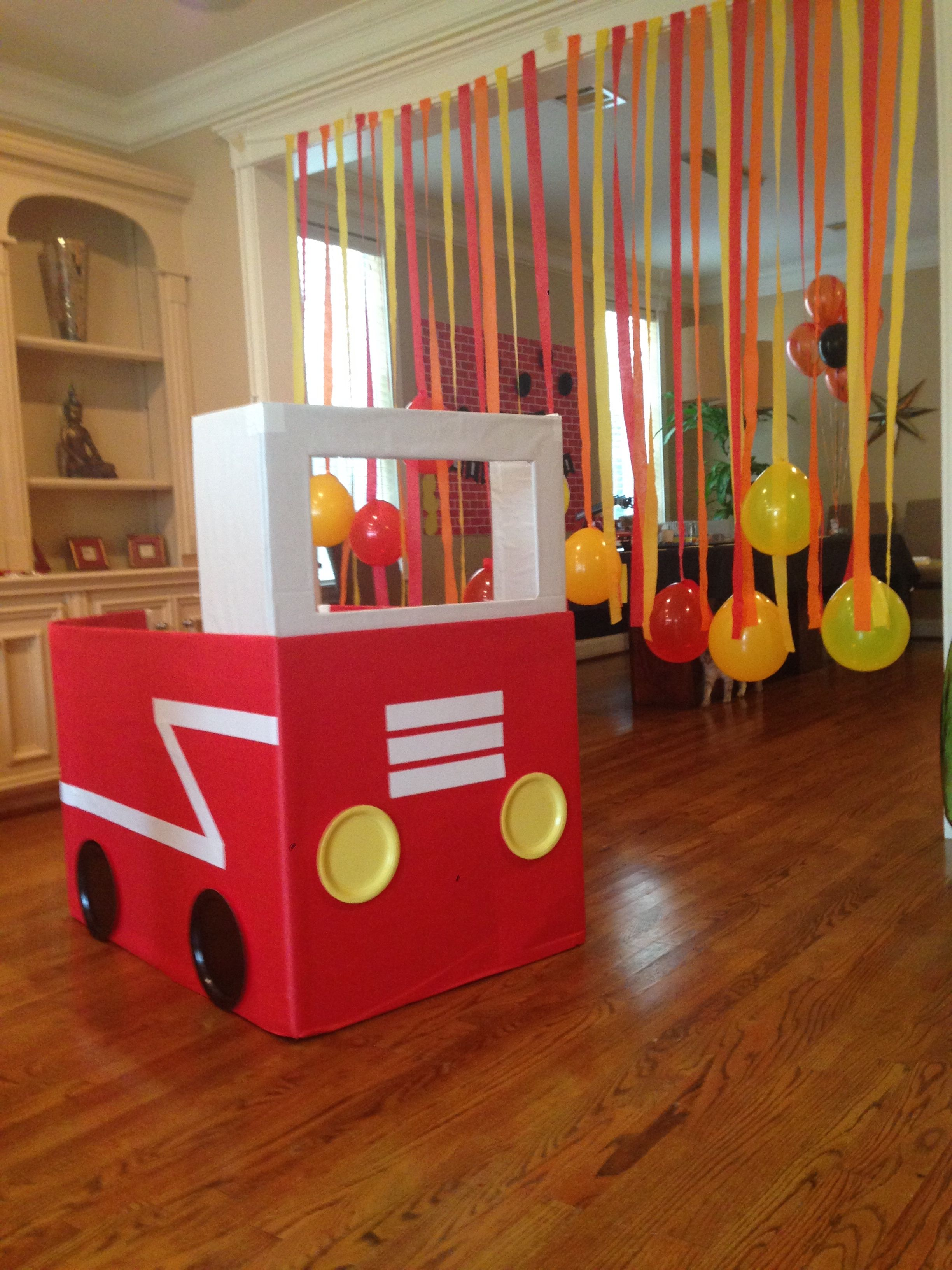 Firefighter birthday party Fire truck made with a large box and
