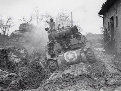 Sherman's of the US 9th Army in German mud, early 1945