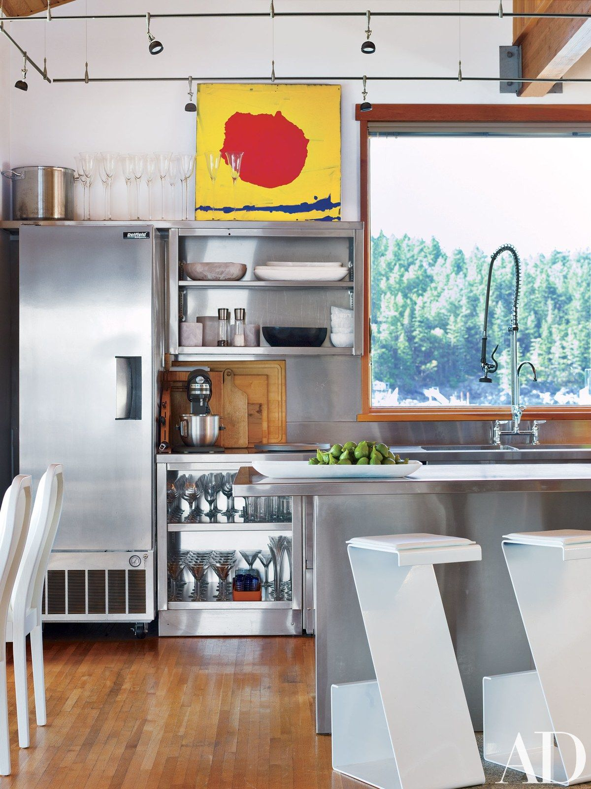 In the kitchen a bright wall sculpture is propped atop stainless