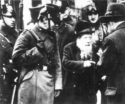 An Elderly Jew Being Taken Into Custody By Berlin Police border=