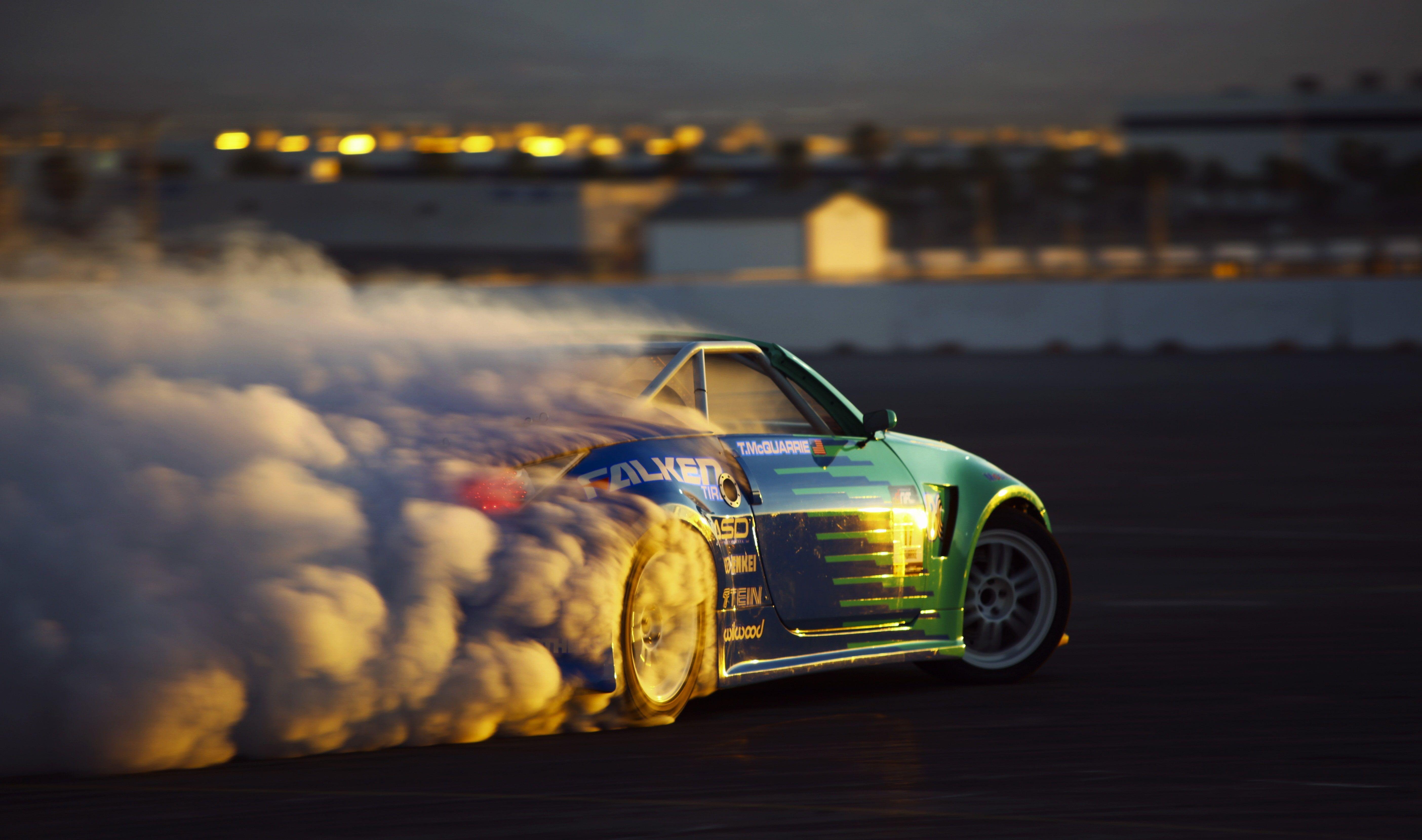 Car Smoke Burnout Sports Car Sunlight 5k Wallpaper Hdwallpaper Desktop Car Wallpapers Car Sports Wallpapers