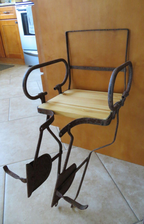 Rusty Antique Child's Buggy Bike Seat Turned into Bookshelf by OldBeaverAntiques on Etsy https://www.etsy.com/listing/198343876/rusty-antique-childs-buggy-bike-seat