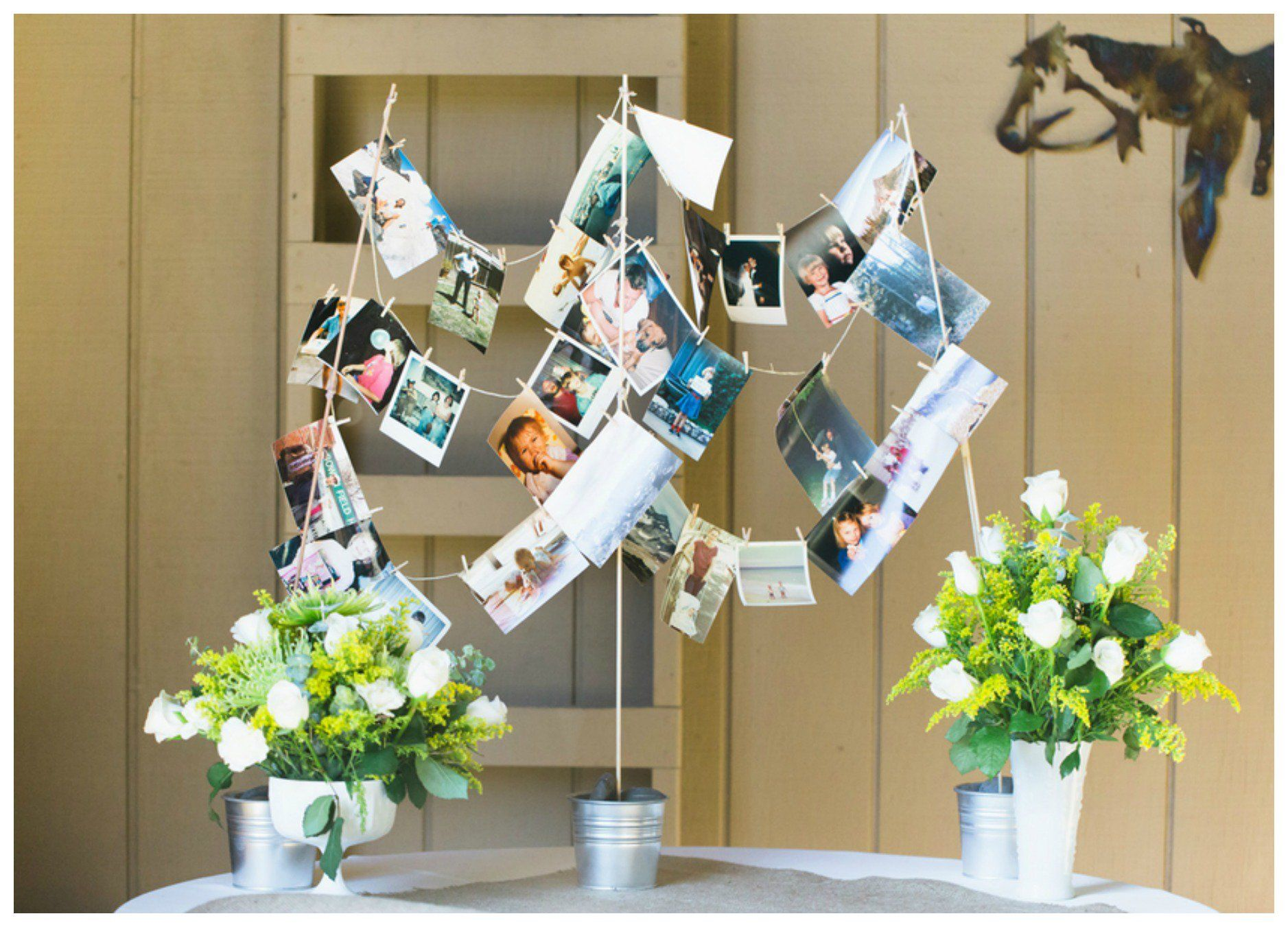Welcome Table Clothesline...Go Low tech with the slideshow and share your favorite pics of the bride and groom.  Adorable!