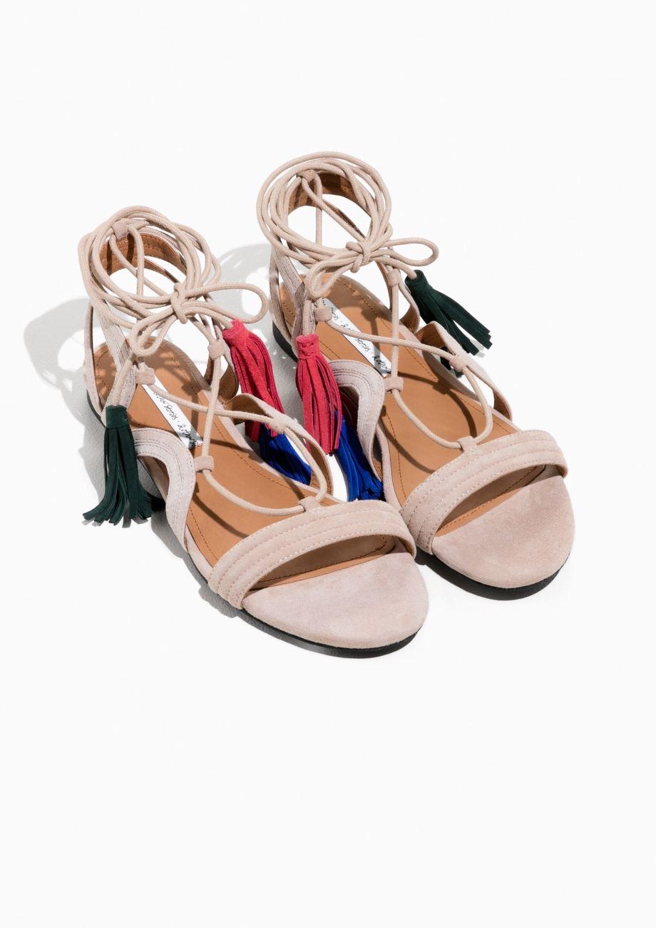 Suede Lace Up Tassel Sandal in Beige