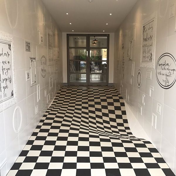 Optical illusion hallway is designed to look like the for Floor illusions