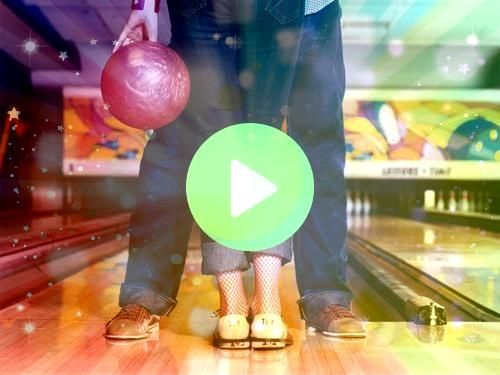 a heavy ball down a wooden lane in an attempt to knock down 10 pins is a Tossing a heavy ball down a wooden lane in an attempt to knock down 10 pins is aTossing a heavy b...
