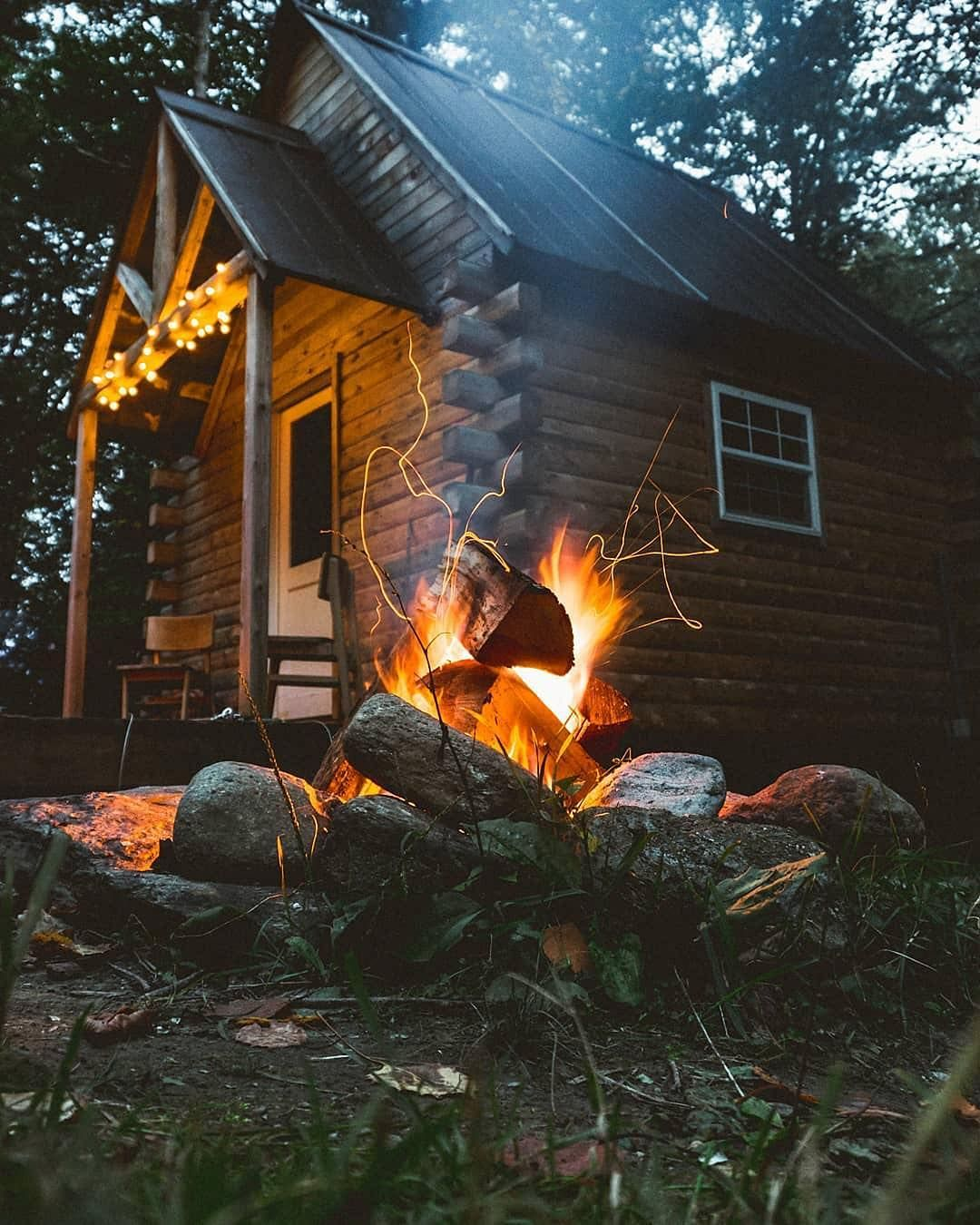 Cozy Log Cabin On Instagram It Doesn T Get Much Better Than Sitting At A Fireplace Outside Your Cabin Tag Who Wou Cabins In The Woods Cabin Winter Cabin