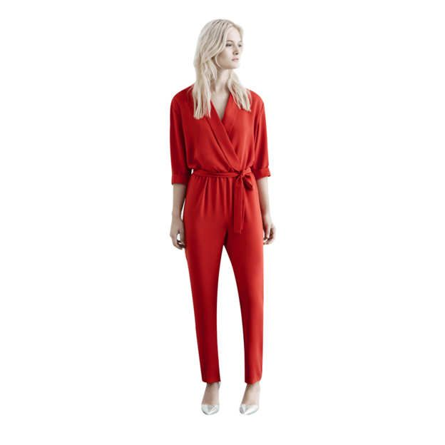 It's easy to fall into a neutral rut, but a bright-red jumpsuit with a cinched waist and deep V-neck is as flattering as a black one.