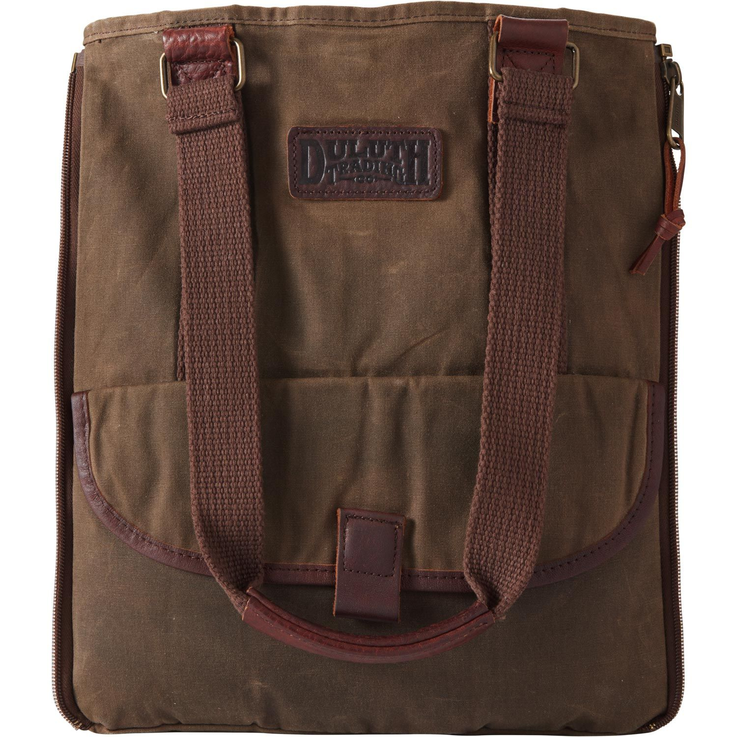 594940bc001 The Oil Cloth Day Tote Bag sheds moisture, resists stains and organizes  essentials in a plethora of pockets. Zippered gussets expand to handle  anything!