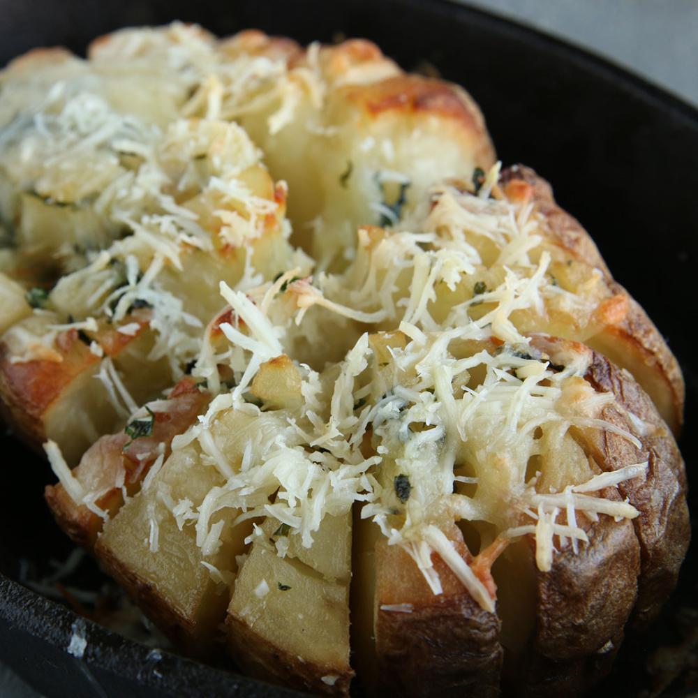 Blooming Baked Potato Recipe By Tasty Recipe Potato Recipes Recipes Healthy Potato Recipes