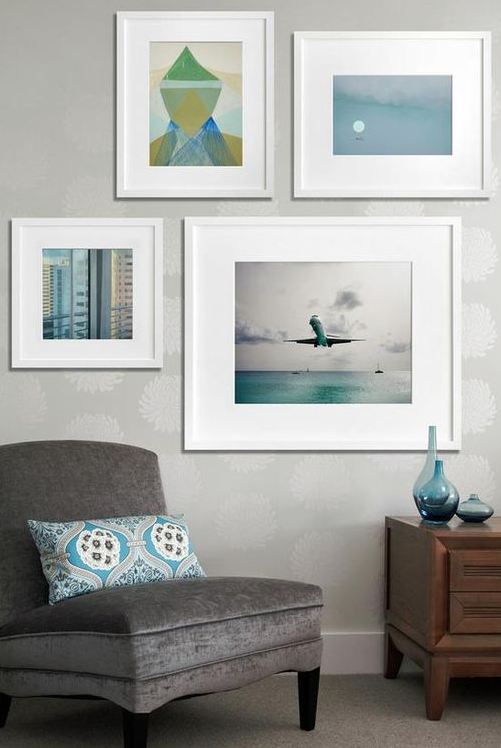 Time to get inspired by this gallery wall. The complimentary colors seal the deal! ---------------- #gallery #wall #picture #frames #custom #framing #home #decor #design