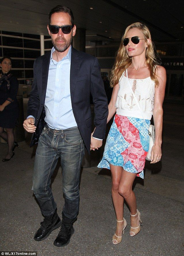 Rejuvenated! The couple looked loved up as they arrived home into LAX Airport just hours after the post on Twitter