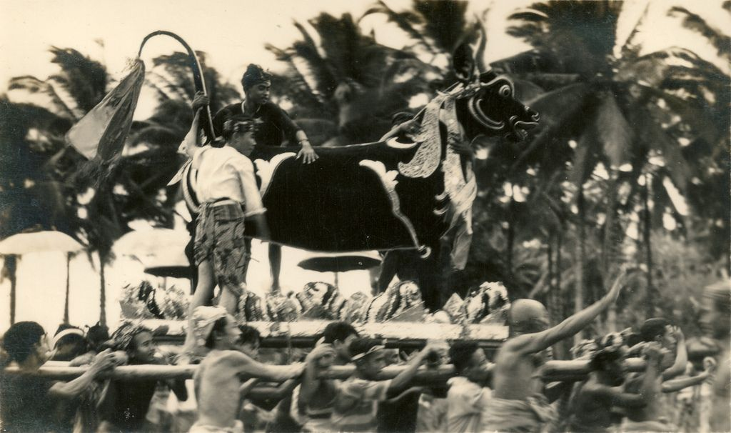 """Whereabouts unknown.  """"Ngaben, or Cremation Ceremony, is the ritual performed in Bali to send the deceased to the next life. [...] The body of the deceased is placed inside a coffin. This coffin is placed inside a sarcophagus resembling a buffalo (Lembu) or in a temple structure (Wadah) made of paper and wood."""" [Wikipedia (2011). Ngaben. (consulted 2012)]"""
