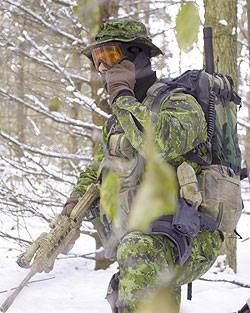 A Canadian special forces ''JTF 2'' soldier talking on the radio during a winter warfare exercise.