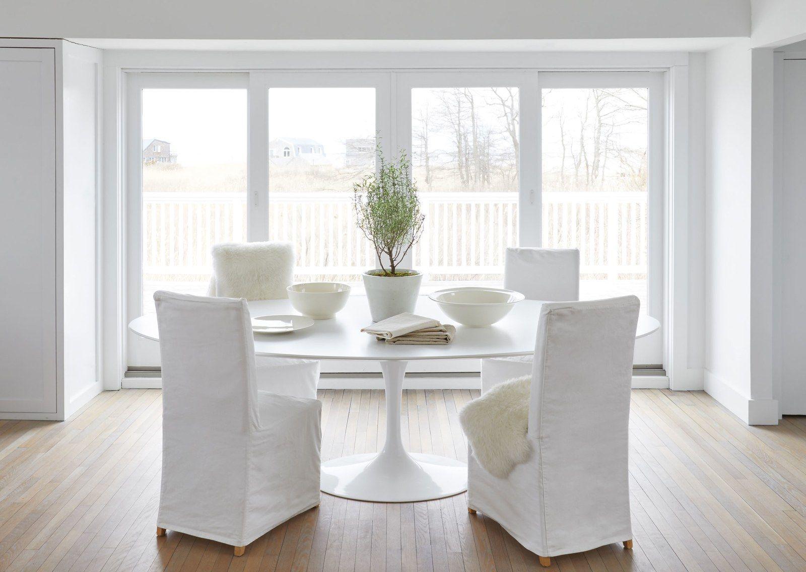 Long Island - slipcovered chairs around a Saarinen table
