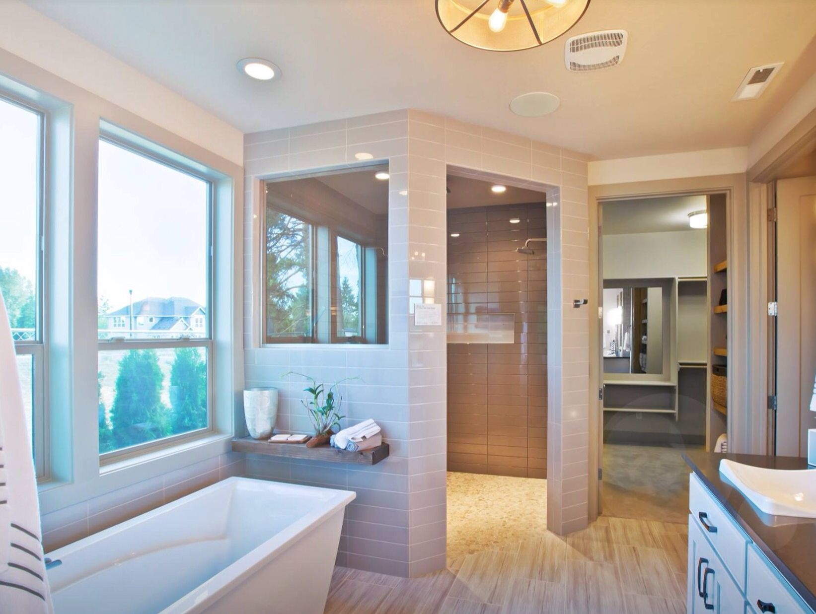 Beautifully done walk-in shower positioned in the corner