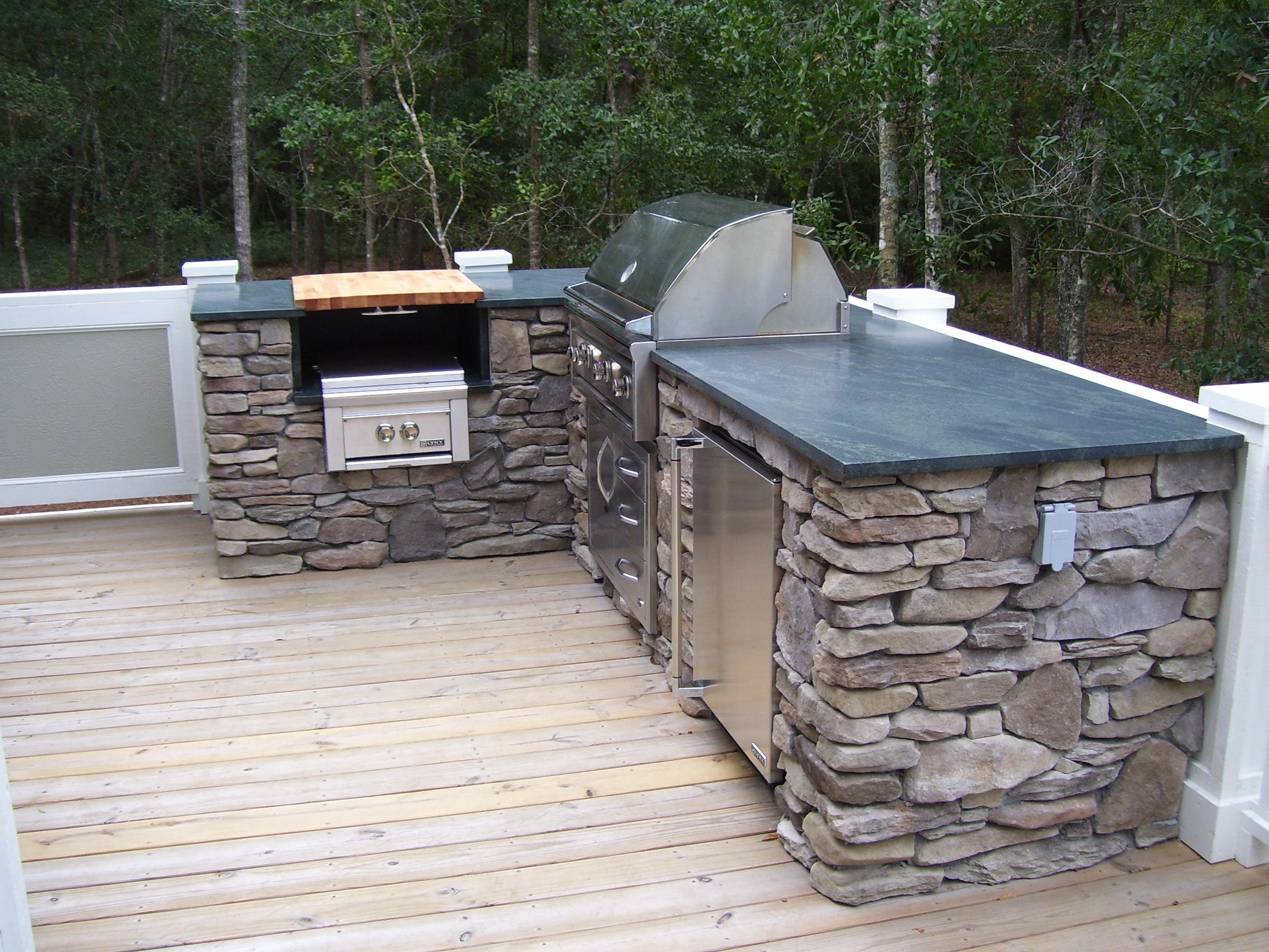 The outdoor kitchen soapstone countertop matches the for Outdoor kitchen equipment