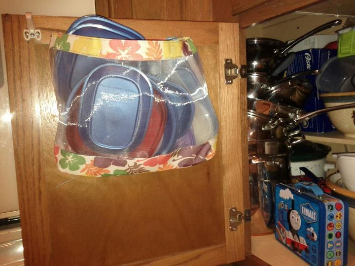 Attach a bag to the inside of the cabinet to hold tupperware lids. I finally did this today! :)
