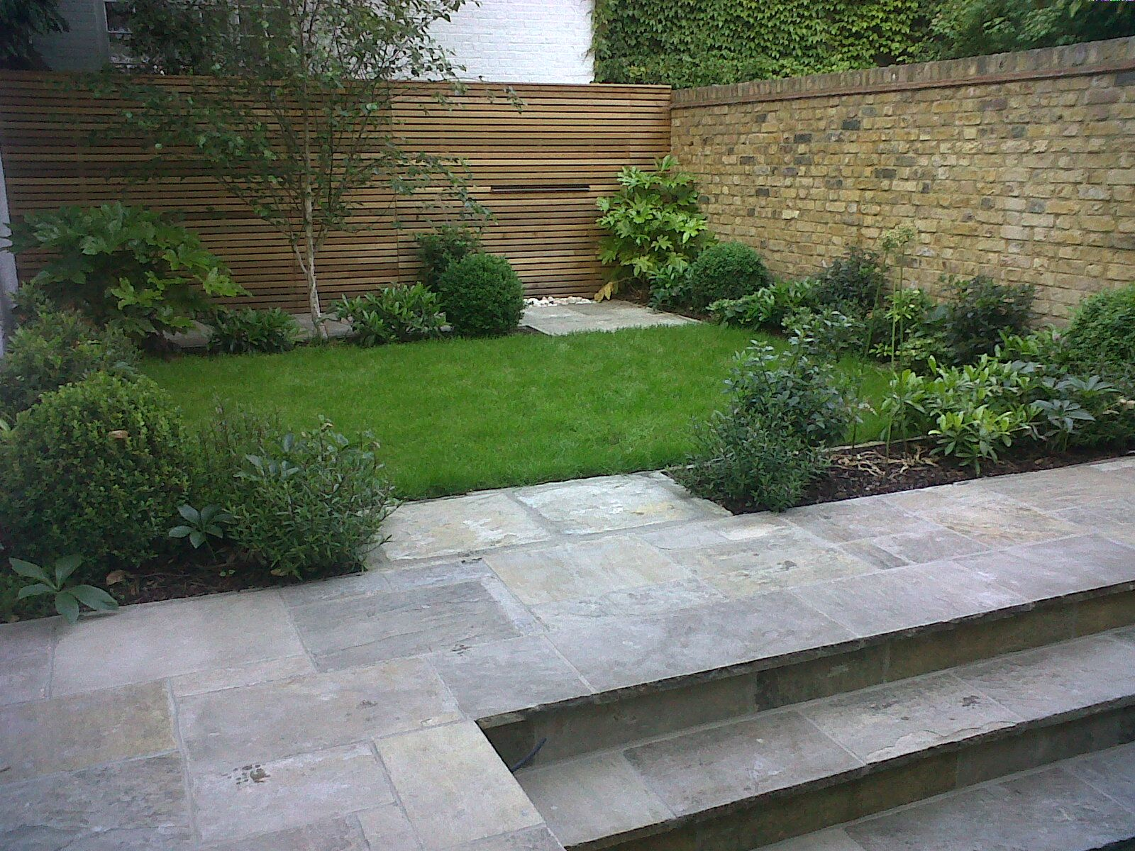 small town garden in central london with reclaimed york stone