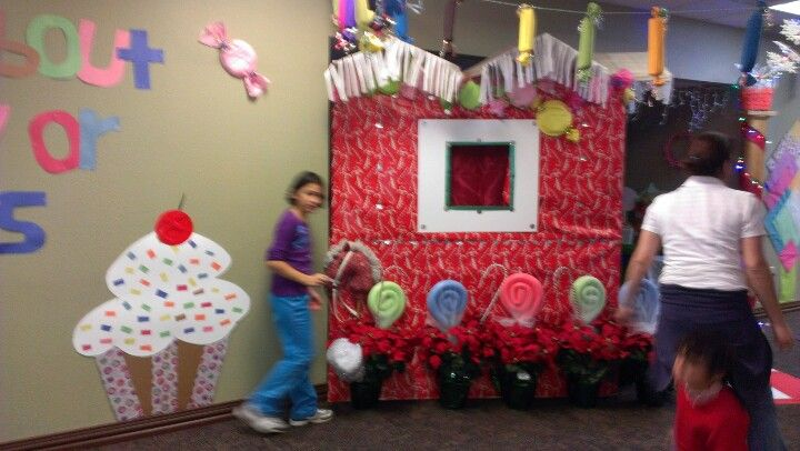 Candy Theme Christmas. Cardboard house wrappep in gift wrap, tissue paper and foam plate candies.