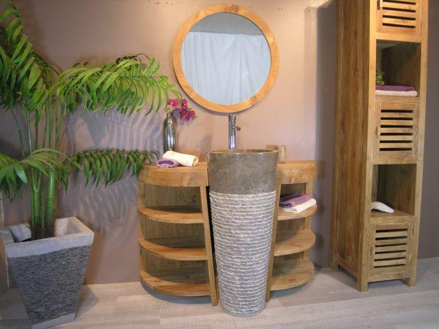 Des meubles de salle de bain en bois et un lavabo original ...