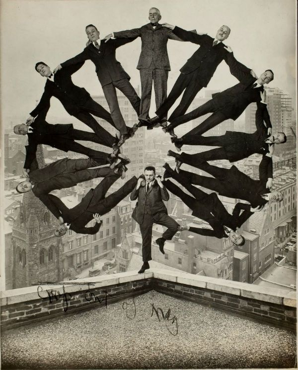 Unidentified American artist, Man on Rooftop with Eleven Men in Formation on His Shoulders, ca. 1930.