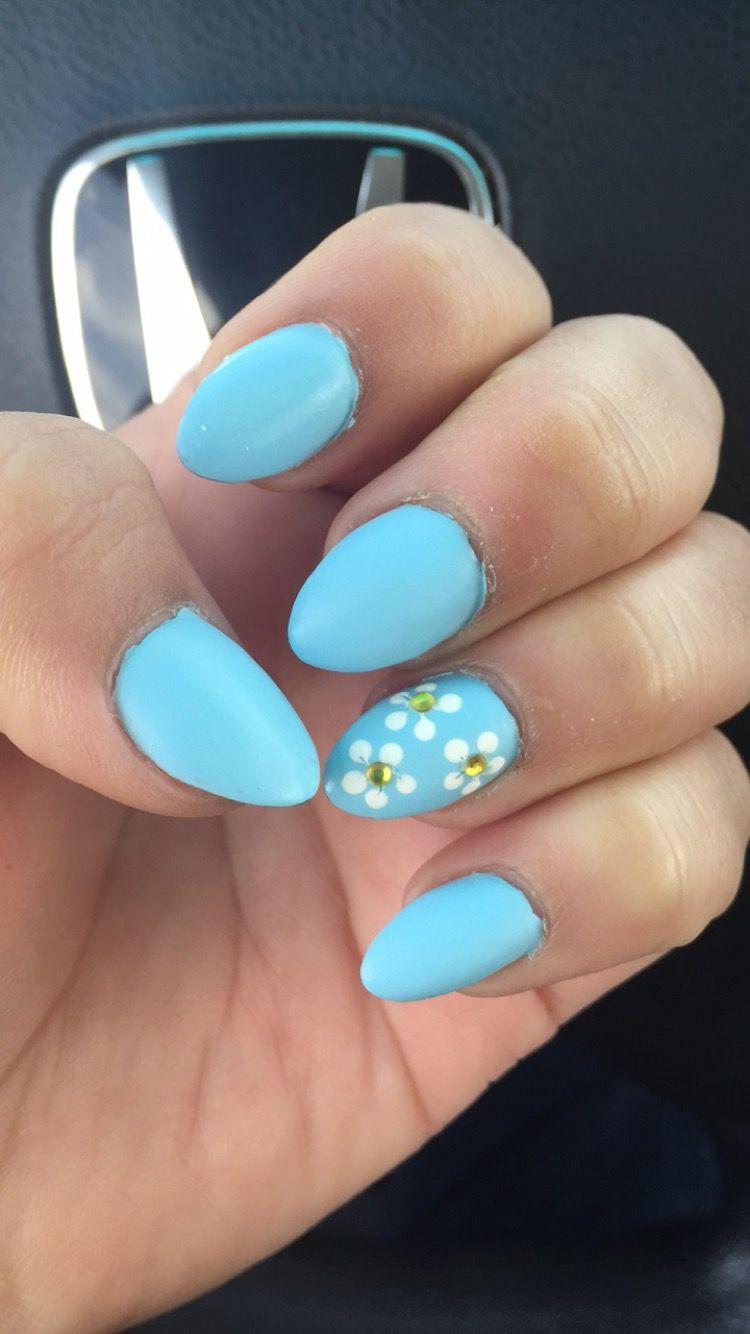 Short Light Blue Matte Almond Nails With White Flowers Blue Nails Acrylic Nails Almond Matte Light Blue Nails