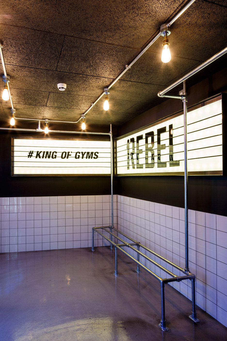 Studio c designs rebel gym to look like a nightclub