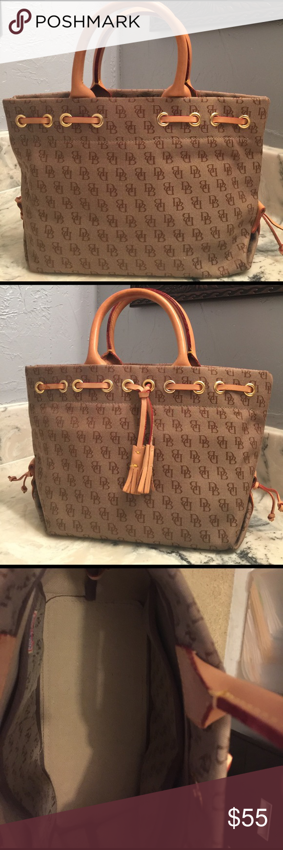 Small Dooney & Bourke tote $55 12 x 8. I've only had it since Christmas.  It's super cute but a little to small for me.  Still in great condition.  Very small scuff mark on one handle and a small water mark on the other - as shown in the pictures.  Inside of bag is very clean but hard to get picture without shadowing.  No pen marks.  Comes with a shoulder strap that has never been used. Dooney & Bourke Bags Totes