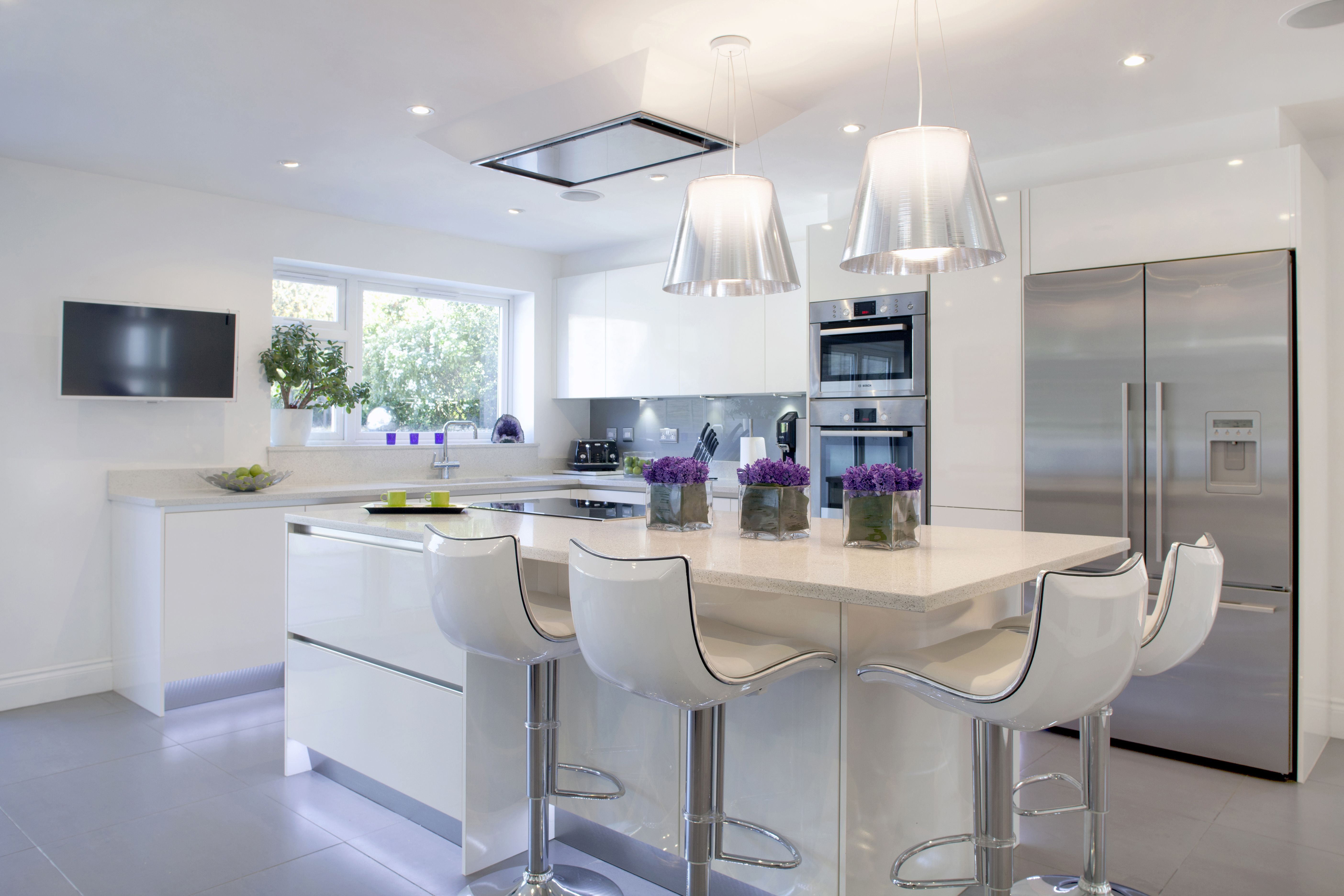 Clean Design, White with dining island. #Kitchen #DiningRoom #CleanDesign #White #PurpleFlowers #KitchenIsland #Braverman #kitchenextensions