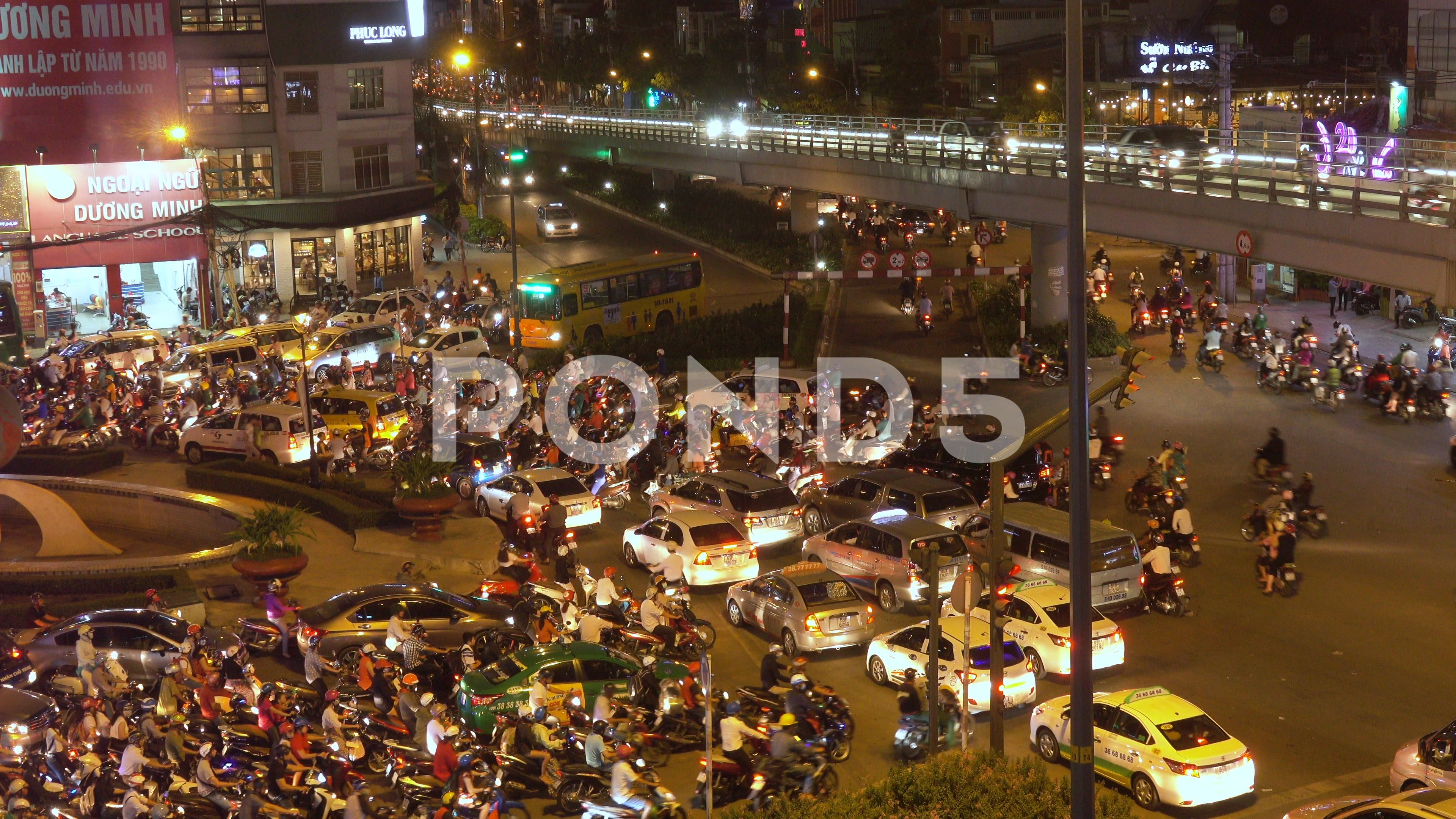 Drone Flying Above Countless Vehicles In The Bustling Streets Of