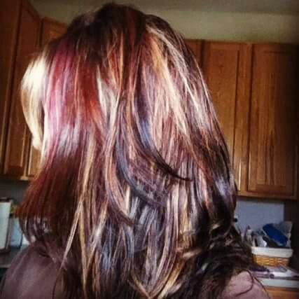 Dark hair with highlights and red lowlights
