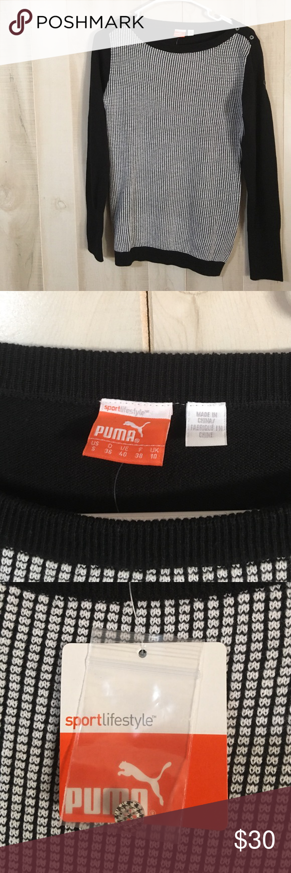 """NWT Puma Long Sleeve Active Sweater Size Small NWT Puma Long Sleeve Active Sweater , extra Button with tag, black and white design, non-Smoking home......................... Measurement at arm pit without stretching the material is 17"""" Puma Sweaters"""