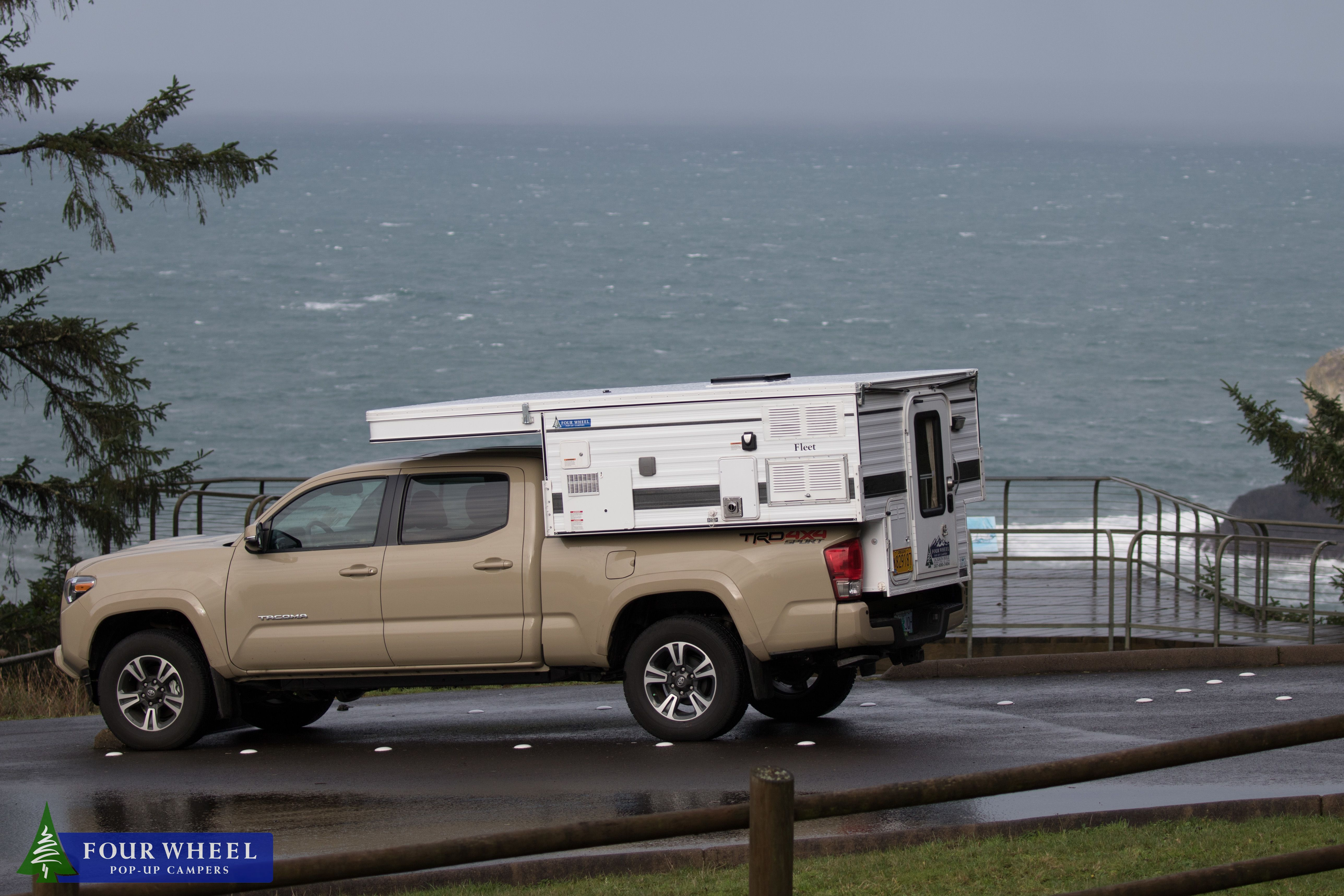 Off Road Camper In A Quicksand Toyota Tacoma By The Ocean