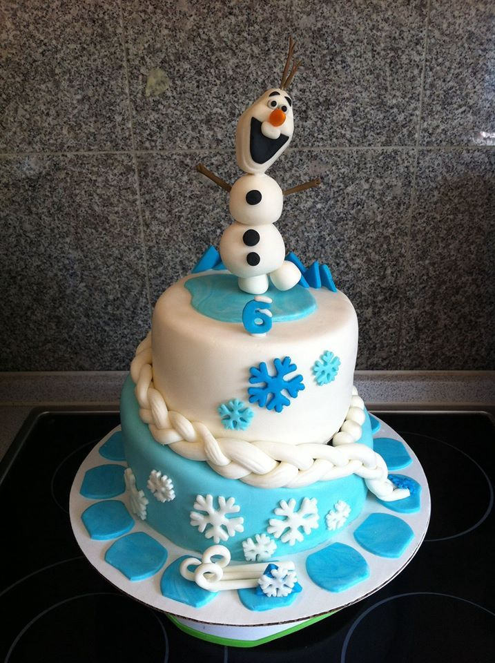 Frozen themed cake Topsy Turvy style withElsas hair braided
