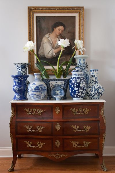 Blue and white Chinese porcelain collection on French style ormolu chest.