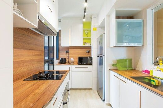 White kitchen with Kompacplus top and pops of colours modern