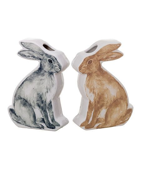 A detailed bunny illustration lines these two vases to present floral arrangements in a darling spring-fresh style.