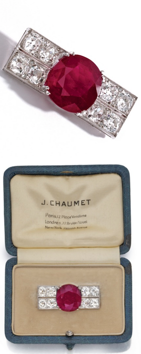 PLATINUM, RUBY AND DIAMOND BROOCH, CHAUMET, FRANCE, CIRCA 1920 Set in the center with a cushion-shaped ruby weighing 10.00 carats, flanked by old mine diamonds weighing approximately 4.40 carats, partial maker's mark for Chaumet, French assay marks. With fitted box signed J. Chaumet, the front stamped Anne.