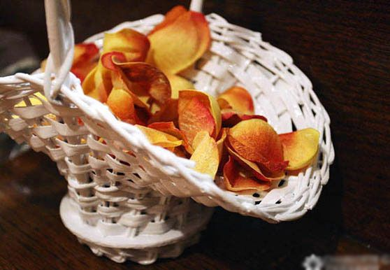 Flower girl basket with orange rose petals