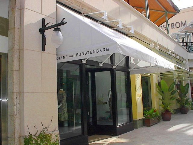 Commercial Awning Lean To Style For Outdoor Mall Or Storefront Setting Diane Von Furstenberg Village Of Merrick Storefront Design Merrick Park Awning Canopy