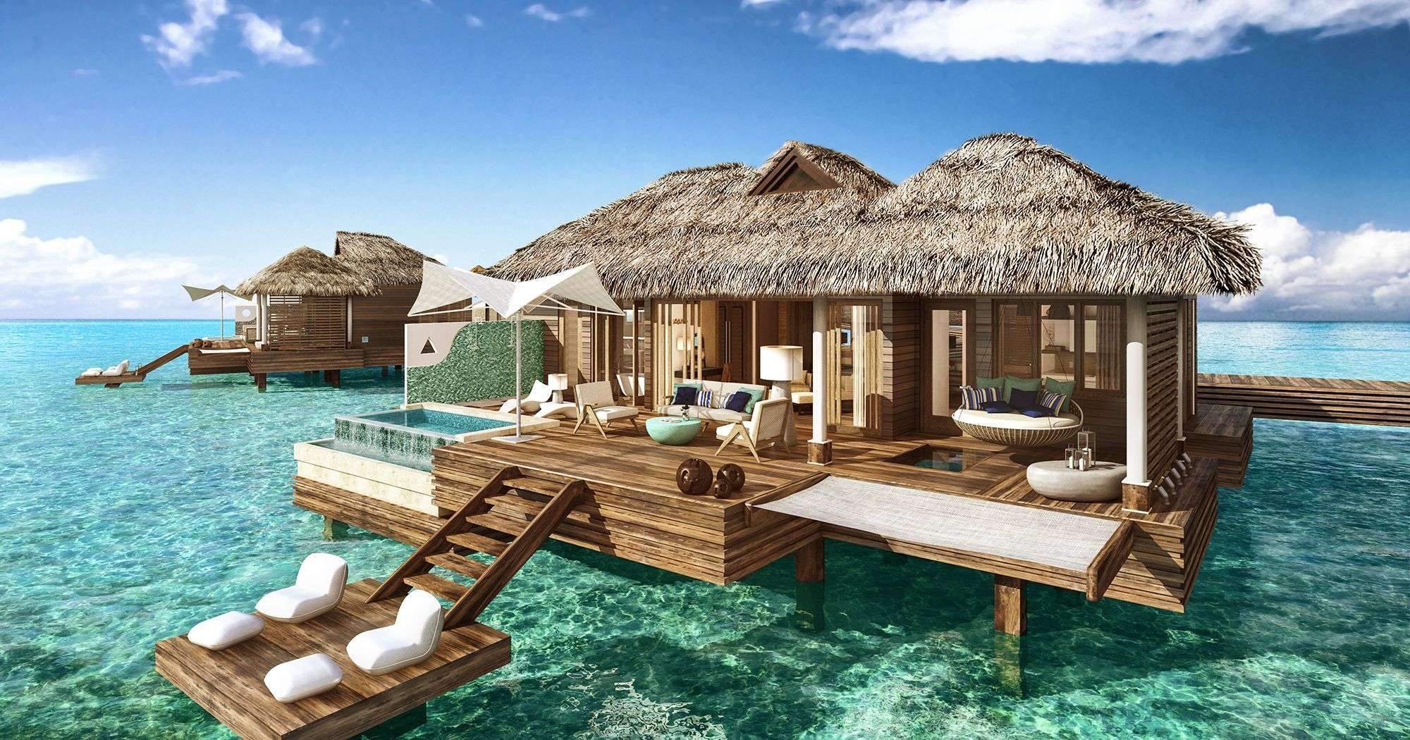 Imagine the most over-the-top hotel you've ever seen, and then multiply it by 100. That's what you'll find at Sandals' just announced foray into the luxury all-inclusive space.  The Over-The-Water Suites at Sandals Royal Caribbean in Montego Bay, Jamaica, are a group of five incredible