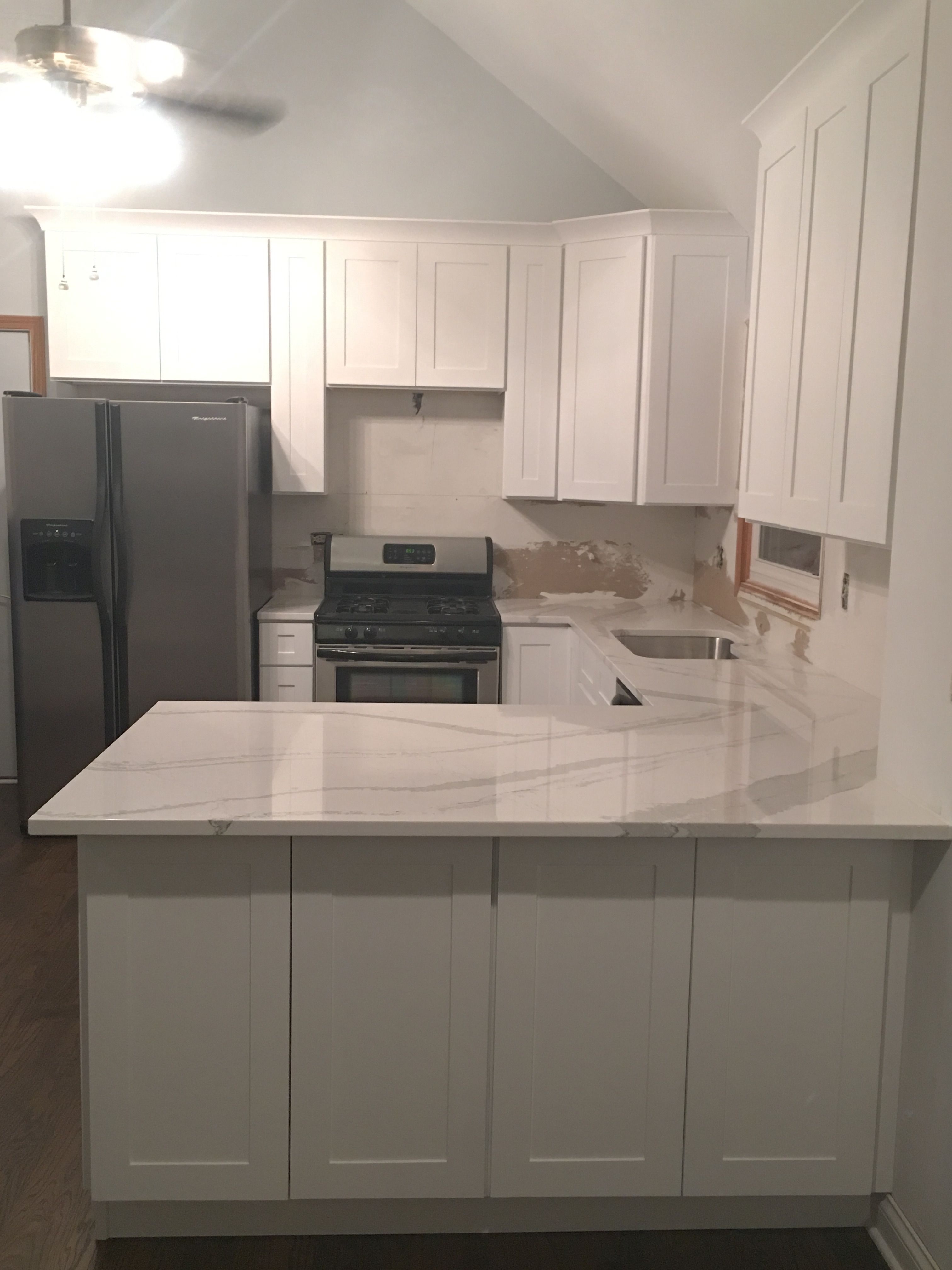 Kitchen renovation all white cabinets with quartz for Kitchen renovations with white cabinets