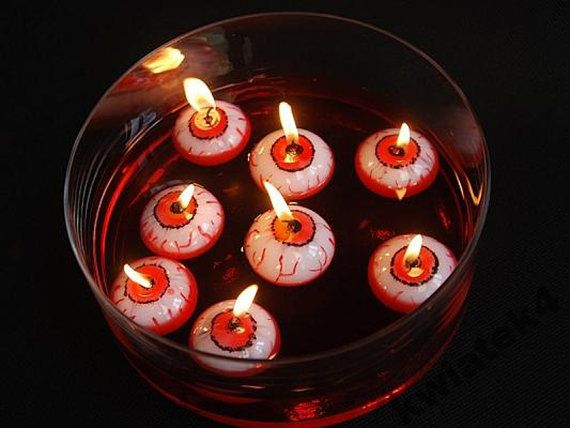 Spooky Halloween eyeball candle floats on by HandMadeDesignsGraph