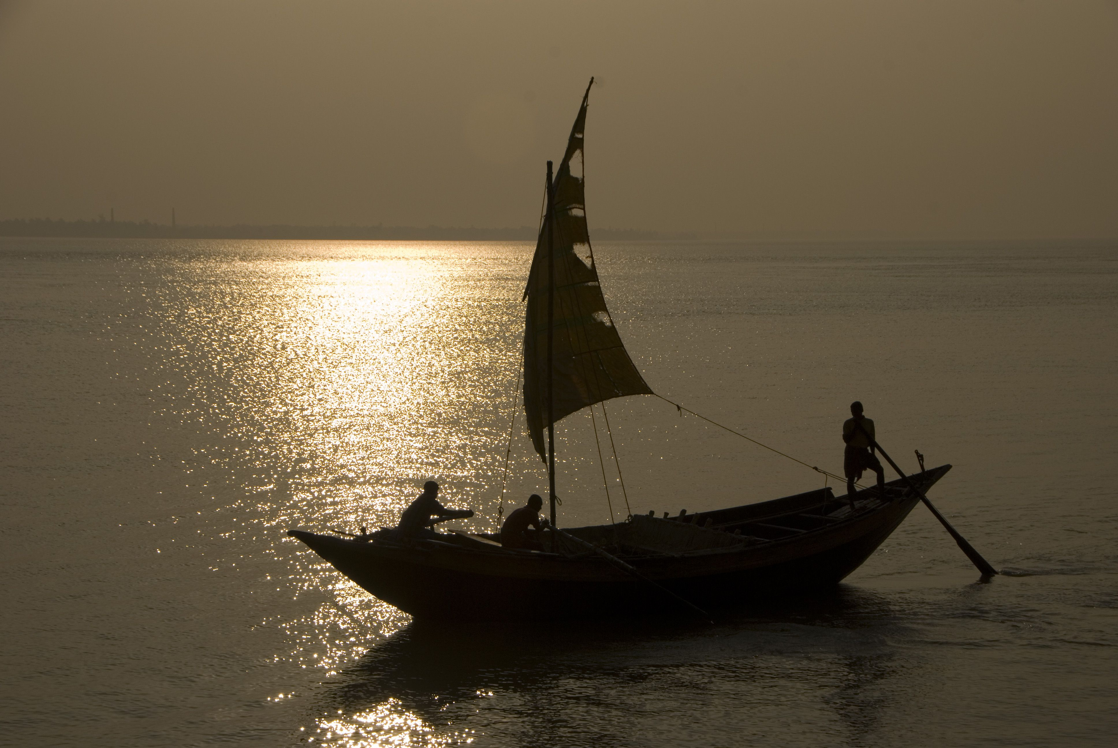Boat returns to the banks as the sun sets.