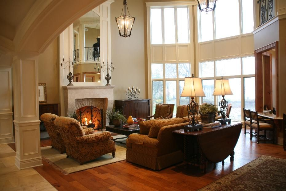 Warm, inviting living room design with tall ceilings ...