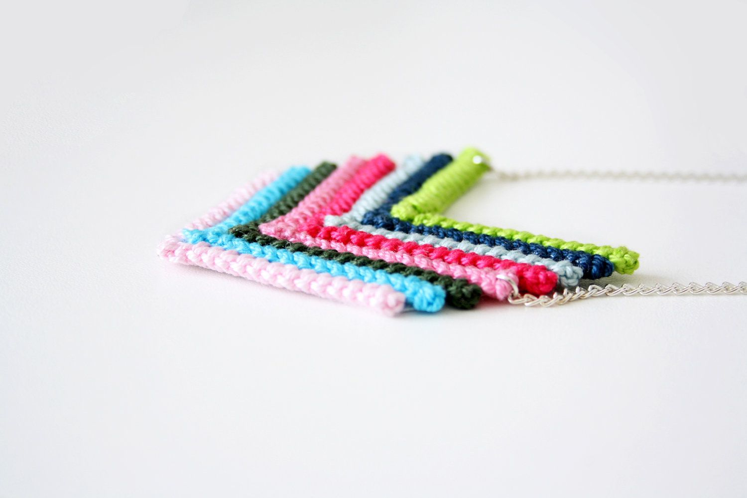 crochet chevron, arrow pendant in soft pastel colors with a chain ...