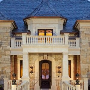 mediterranean-house-exterior-with-elegant-balcony-design-with-beige-wall-color-with-bricks-stone-material-also-elegant-house-front-door-design-with-elegant-entry-staircase-and-modern-wall-lights-design